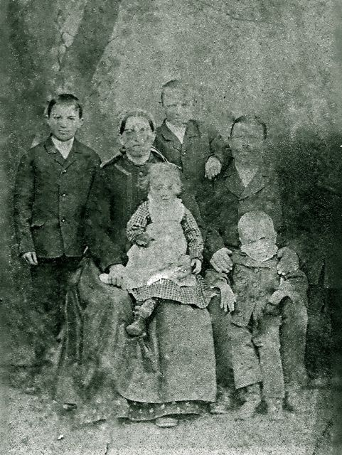 Johannes Roth Family (1886) Johannes Roth, wife Anna Shuster, and 4 of their children, Matyas, Robert (standing), Maria, & Adolph. Their son John is actually in the picture on the right but has faded out except for his feet and legs.